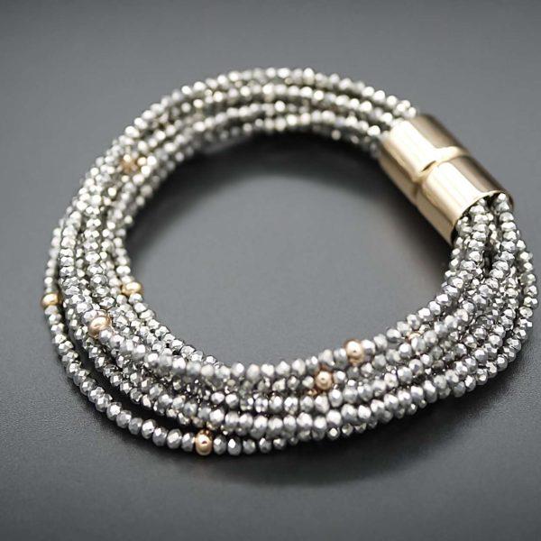 Bracelet aus Glaskristallen und Stahl, vergoldet